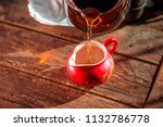 pour tea into the red chinese... | Shutterstock . vector #1132786778