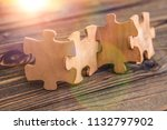 placing a piece of the puzzle... | Shutterstock . vector #1132797902