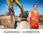 worker with bulldozer in road... | Shutterstock . vector #1132825526