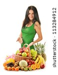 Young woman with variety of fruits in wicker basket isolated on white - stock photo