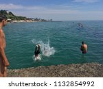 children jumping into the sea...   Shutterstock . vector #1132854992