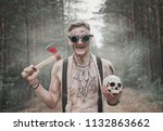 cannibal man in glasses with ax ...   Shutterstock . vector #1132863662
