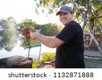 barbeque party near lake or... | Shutterstock . vector #1132871888