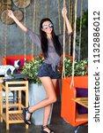 pretty hipster woman having fun ... | Shutterstock . vector #1132886012
