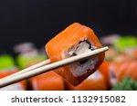 mens hand holding wooden sticks ... | Shutterstock . vector #1132915082