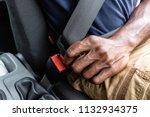 black man's hand fastens seat... | Shutterstock . vector #1132934375