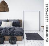 mock up poster in bedroom... | Shutterstock . vector #1132942268