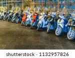 group of motorcylces parked at... | Shutterstock . vector #1132957826