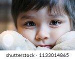 closeup face of little boy... | Shutterstock . vector #1133014865