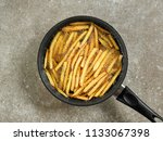 frying french fries in a pan... | Shutterstock . vector #1133067398