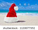 red xmas or christmas santa hat ... | Shutterstock . vector #1133077352