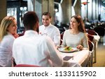 two cheerful couples sitting at ...   Shutterstock . vector #1133115902