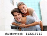 man giving piggyback ride to... | Shutterstock . vector #113319112