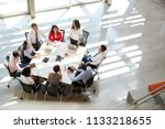businesswoman addressing team... | Shutterstock . vector #1133218655