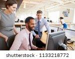 three happy colleagues looking... | Shutterstock . vector #1133218772