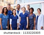 smiling medical team standing... | Shutterstock . vector #1133220305