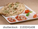 paneer kulcha with stuffing the ... | Shutterstock . vector #1133241638