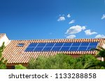 solar panels on the roof of a...   Shutterstock . vector #1133288858