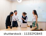 a diverse team stand around a... | Shutterstock . vector #1133292845