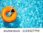 a young girl enjoys a... | Shutterstock . vector #1133327795