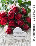 valentines day roses and heart with german 14. Februar Valentinstag - stock photo