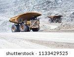 huge dump trucks in an open pit ... | Shutterstock . vector #1133429525