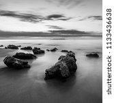 rock on coast | Shutterstock . vector #1133436638