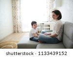 beautiful brunette mom and son... | Shutterstock . vector #1133439152
