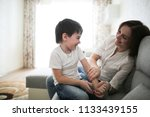 beautiful brunette mom and son... | Shutterstock . vector #1133439155