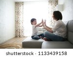 beautiful brunette mom and son... | Shutterstock . vector #1133439158