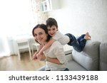 beautiful brunette mom and son... | Shutterstock . vector #1133439188