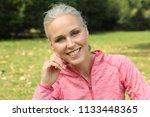 mature woman outside | Shutterstock . vector #1133448365