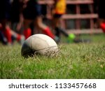 old rugby football on the green ... | Shutterstock . vector #1133457668