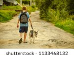 Stock photo a boy on a walk with a dog 1133468132