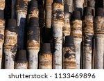oil drill pipe. rusty drill... | Shutterstock . vector #1133469896