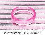 pink circle glass icon on...