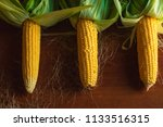 freshly picked corn on a... | Shutterstock . vector #1133516315