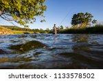 over underwater shot of a man... | Shutterstock . vector #1133578502
