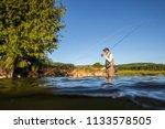 over underwater shot of a man... | Shutterstock . vector #1133578505