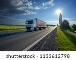 truck driving on asphalt road... | Shutterstock . vector #1133612798