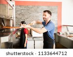 handsome chef wearing black... | Shutterstock . vector #1133644712