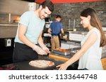 chef wearing gloves preparing... | Shutterstock . vector #1133644748