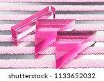 pink arrow fast backward glass...