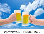 a toast with a draft beer under ... | Shutterstock . vector #1133684522