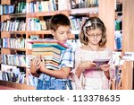Small photo of Boy with books pile and girl with e-reader