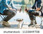 two fishermen frying fish... | Shutterstock . vector #1133849708