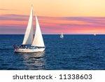 Sailboat Sailing Towards Sunse...