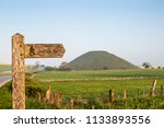 signpost for footpath to... | Shutterstock . vector #1133893556