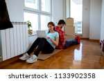 couple moving into new home | Shutterstock . vector #1133902358