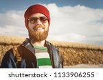 portrait of a young hipster man ... | Shutterstock . vector #1133906255